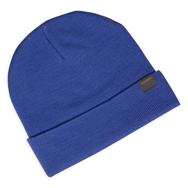 periwinkle merino wool ribbed knit beanie laying flat