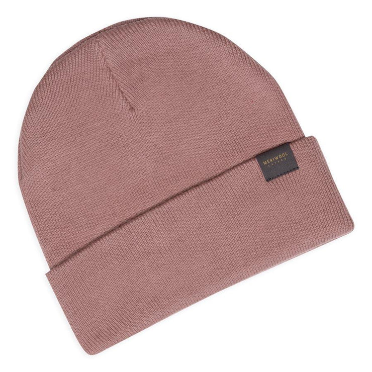 rose colored merino wool ribbed knit beanie laying flat