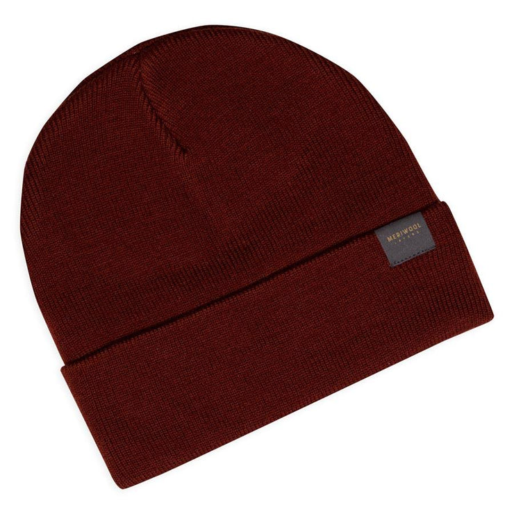 rust colored merino wool ribbed knit beanie laying flat