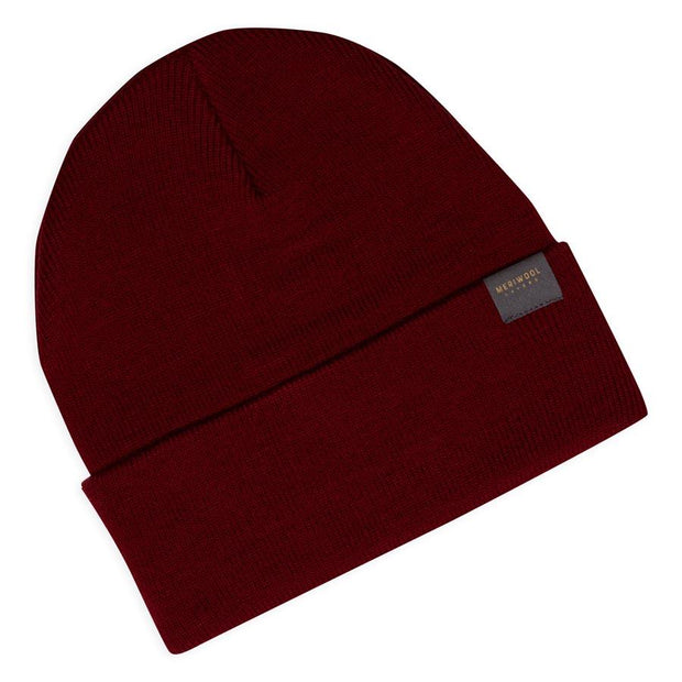 wine colored merino wool ribbed knit beanie laying flat
