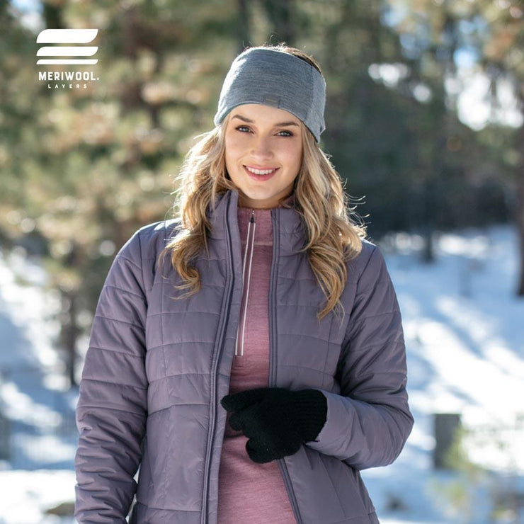 woman outside in the snow wearing heather gray and electric blue reversible merino wool headband