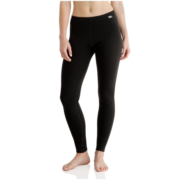 woman wearing a pair of women's black merino wool 400 heavyweight base layer bottoms
