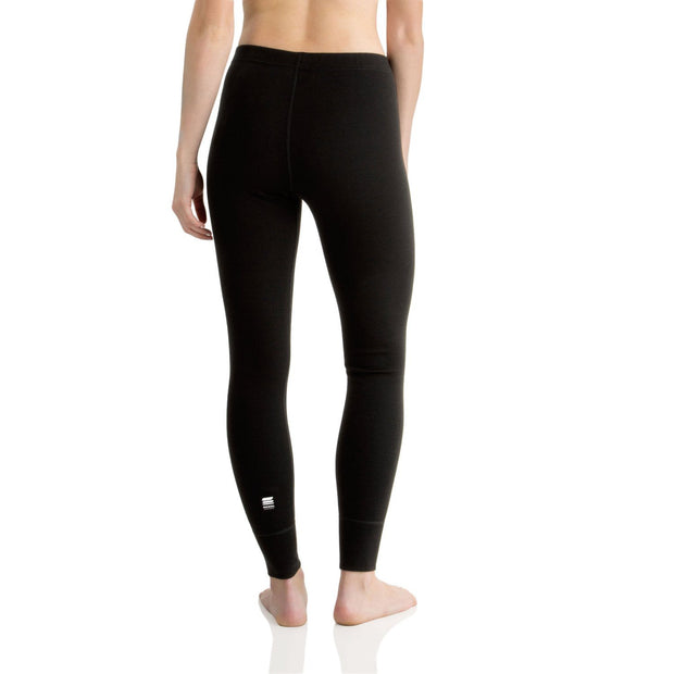 back of a woman wearing a pair of women's black merino wool 400 heavyweight base layer bottoms