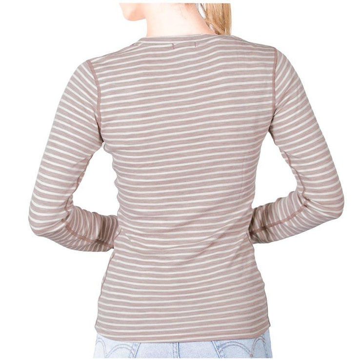back of a woman wearing a women's camel stripe color merino wool 250 base layer top