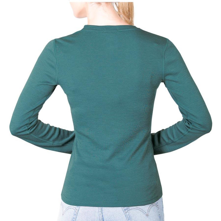 back of a woman wearing a women's teal merino wool 250 base layer top
