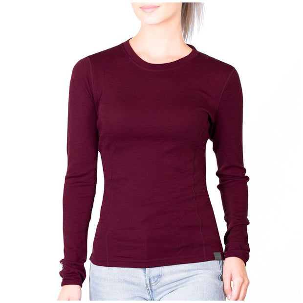 woman wearing a women's wine colored merino wool 250 base layer top