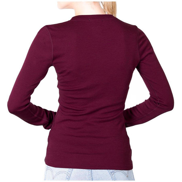 back of a woman wearing a women's wine colored merino wool 250 base layer top