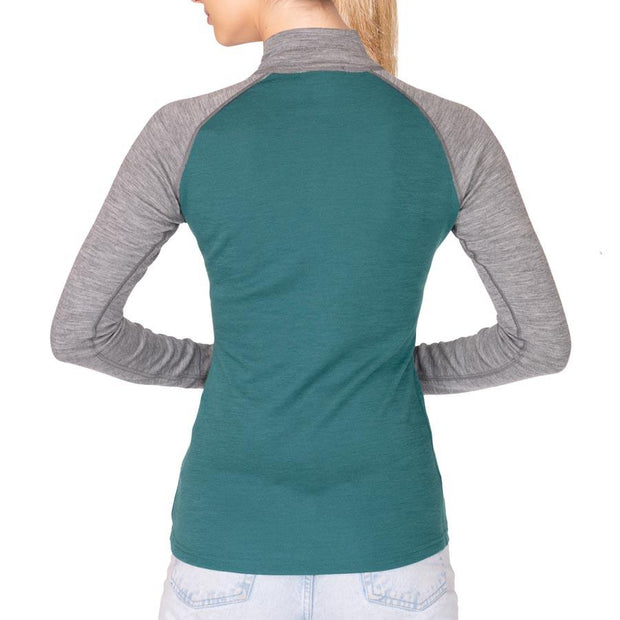 back of a woman wearing a women's teal and gray heather merino wool 250 base layer half zip sweater