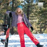 woman in the snow wearing a women's pink heather merino wool 400 base layer half zip sweater and beanie