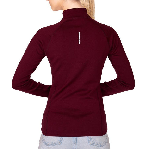 back of a woman wearing a women's wine colored merino wool 400 base layer half zip sweater