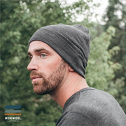man outside wearing a charcoal gray merino wool 250 cuffed beanie