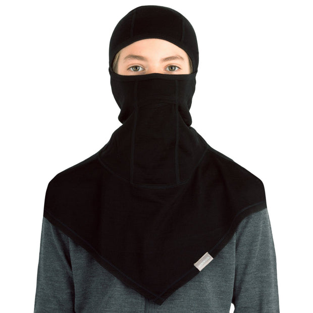 young adult wearing a black merino wool 200 youth balaclava face mask