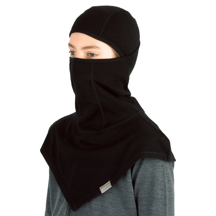 teenager wearing a black merino wool 200 youth balaclava face mask