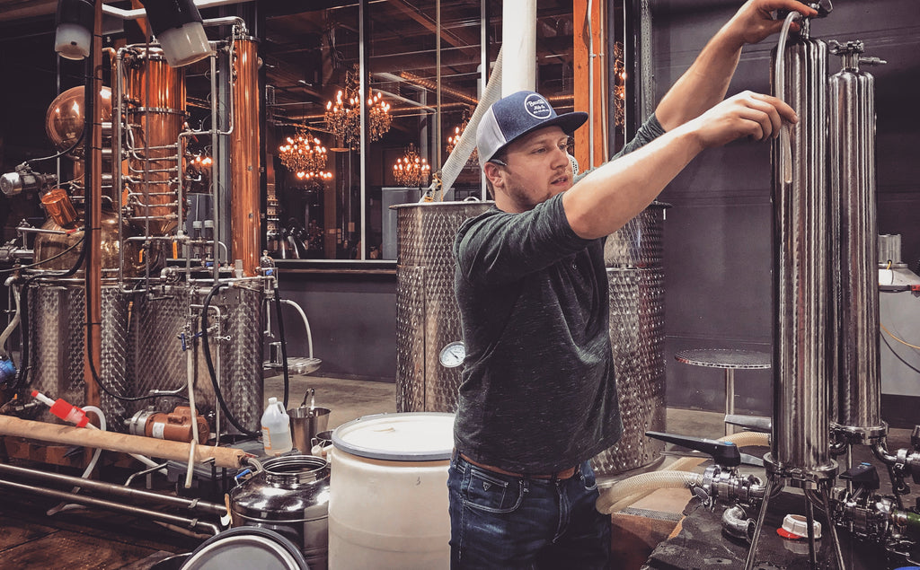 Kyle, working in the distillery