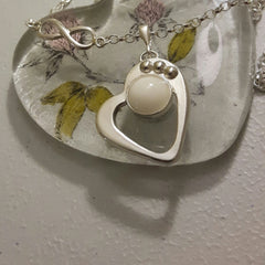 Heart pendant with balls