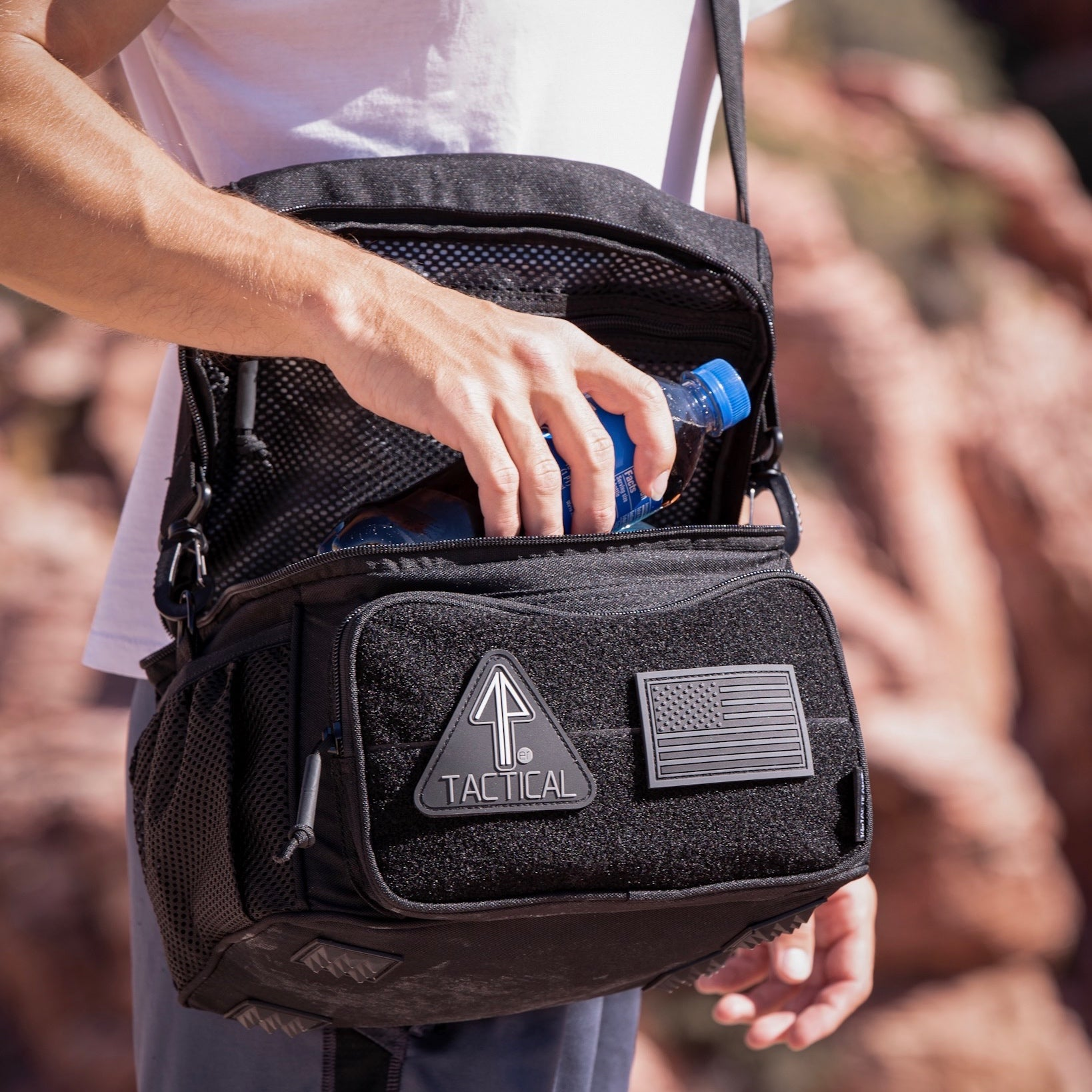 The 14er Tactical Backpack is decorated with morale patches.