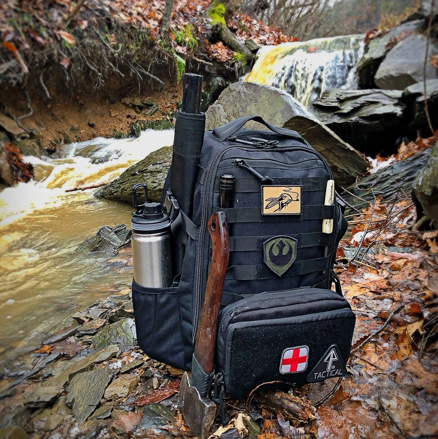 14er Tactical Backpack with molle accessories in the woods