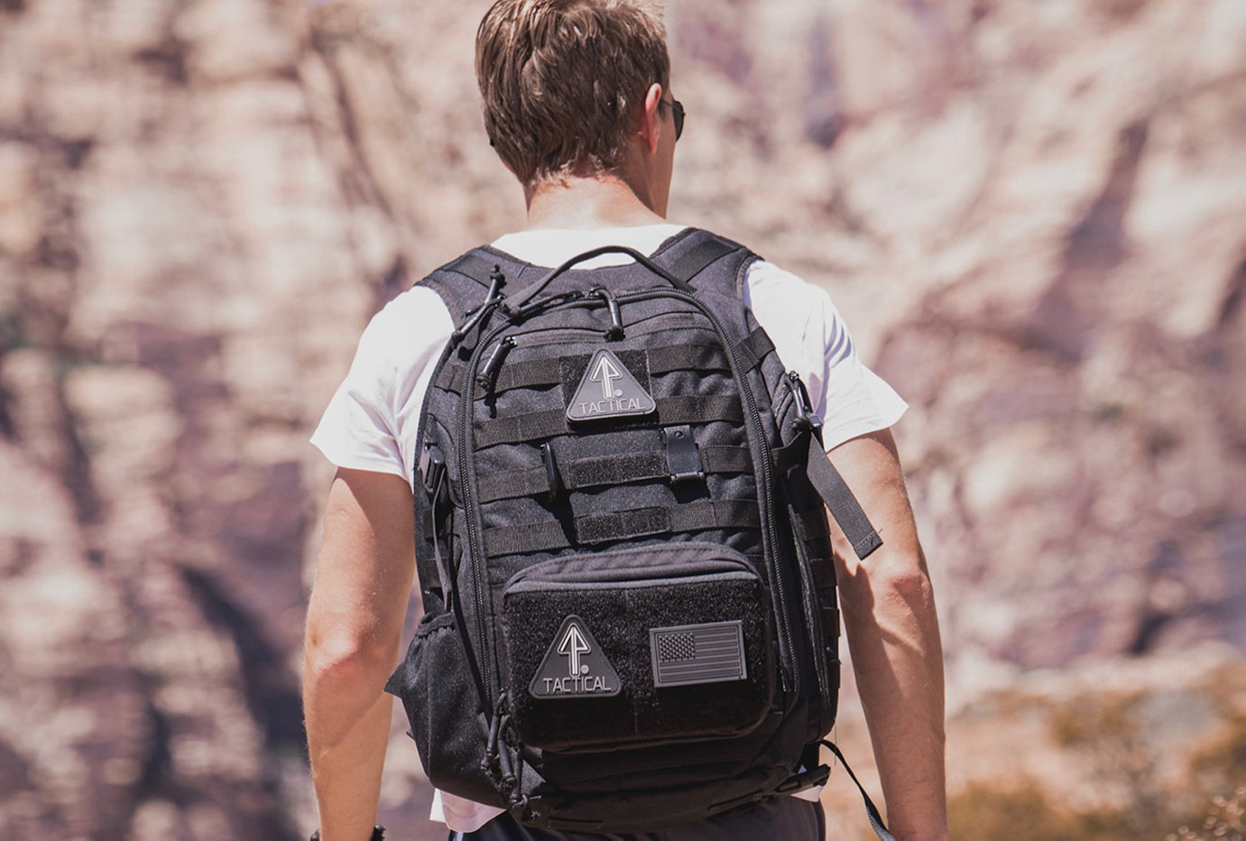 A man wears his EDC 14er Tactical Backpack while adventuring in the outdoors