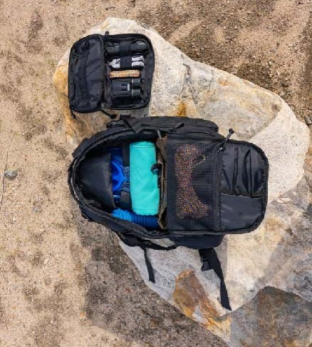 A 14er Tactical Backpack and Admin Pouch is opened to display the EDC, everyday carry, inside.