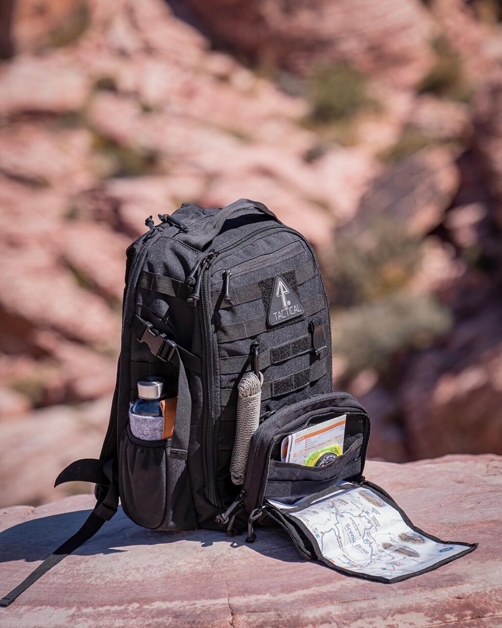 A 14er Tactical backpack that has been used for hiking.