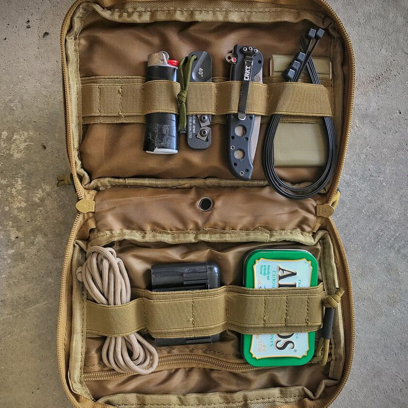 Displaying the everyday carry inside of a 14er Tactical Admin Pouch.