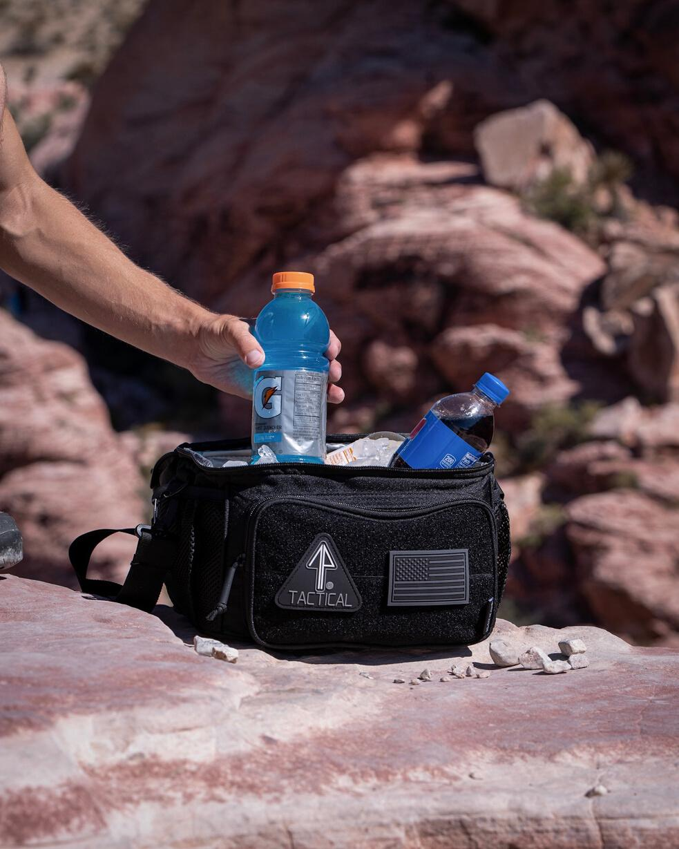 The 14er Tactical Lunch Cooler is used to carry food while camping.