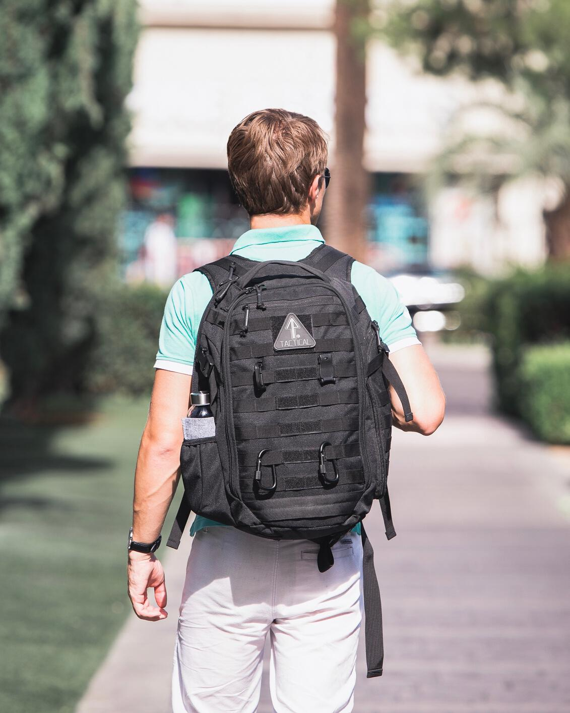 A man uses his clean 14er Tactical backpack for everyday carry.