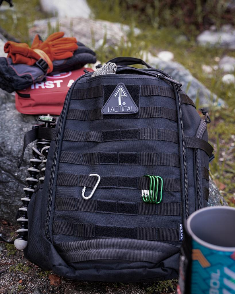 Gear for camping is inside the 14er Tactical Backpack.