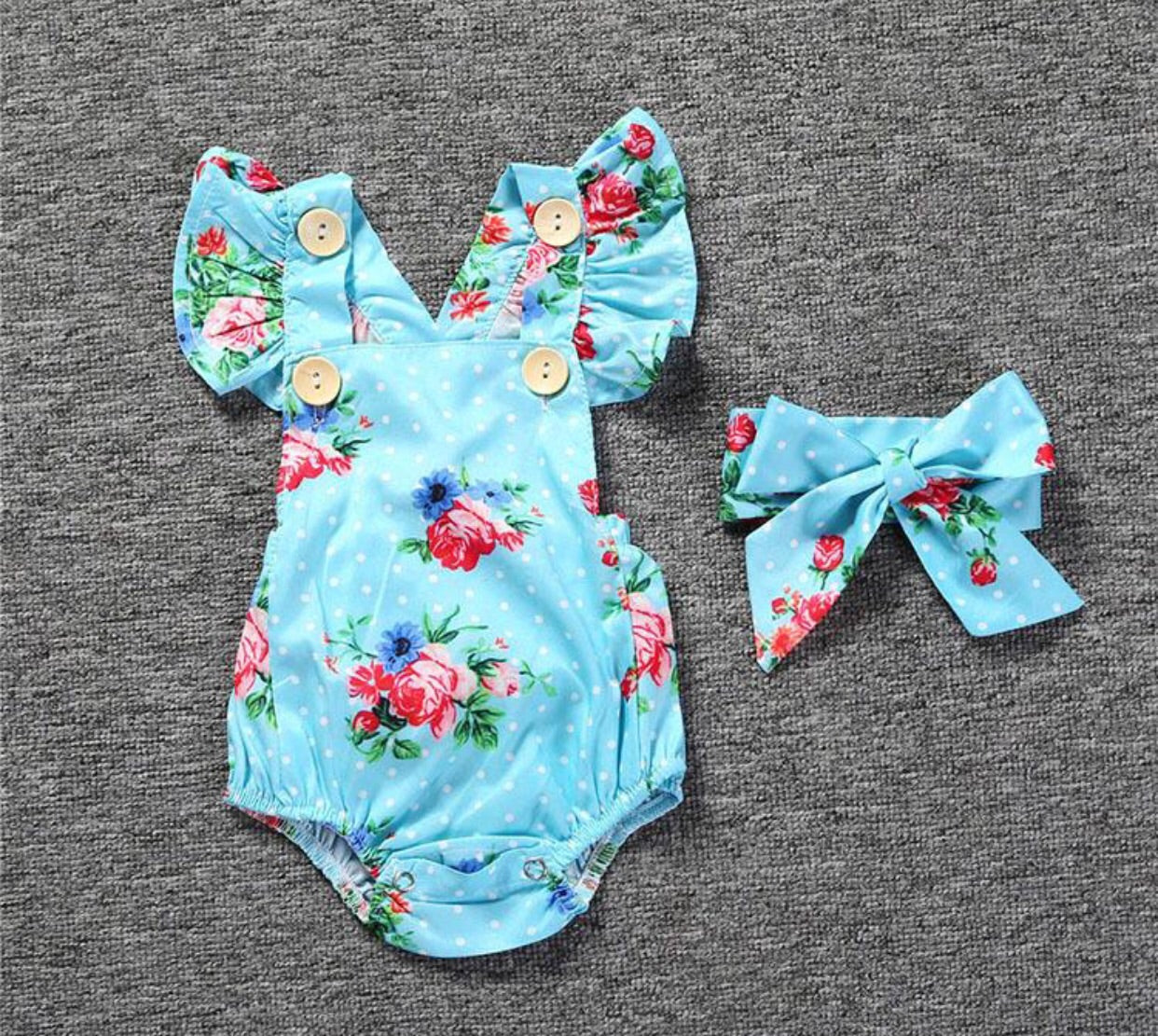 Blue romper with flower patter