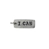 Charm with I Can inscribed on it
