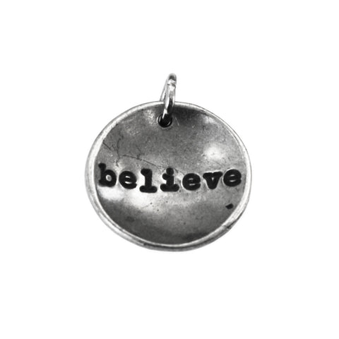 Dish charm with the word Believe inscribed on it