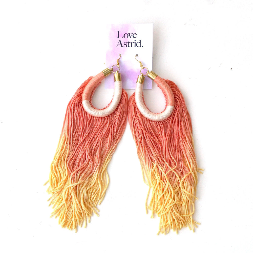 LEFT EYE TASSEL EARRINGS