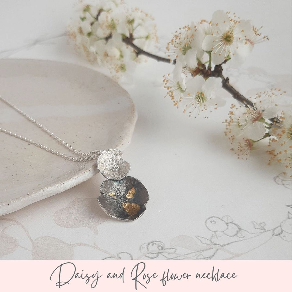 Silver daisy and rose flower necklace