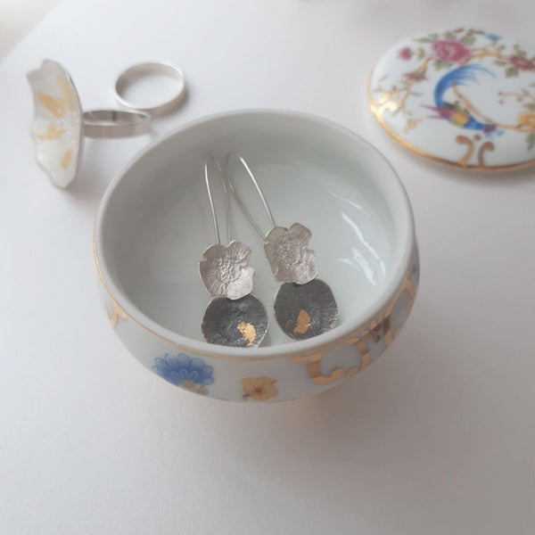 Tinket box with silver earrings