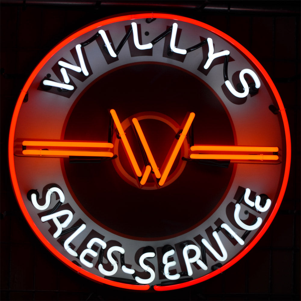 Willys Brand Sales-Service neon sign showing the