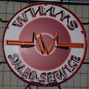 "Willys Brand Sales-Service neon sign showing the ""W"" logo in the center unlit"
