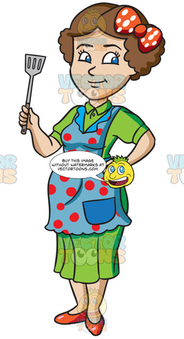 A Woman Holding A Frying Spatula