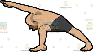 A Man Doing The Extended Side Angle Yoga Pose