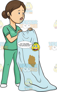 Nurse Holding Up A Soiled Bed Sheet