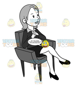 Business Woman Sitting In A Chair With Her Hands Clasped And Legs Crossed