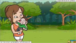 a mom kissing her smiling baby boy and a lush green forest background