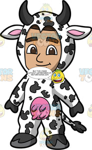 Young Gabriel Dressed Up In A Cow Costume. A Hispanic boy wearing a full body black and white cow costume for Halloween