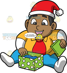 Young James Opening A Christmas Gift. A black boy wearing blue pants, a yellow and white shirt over a red sweater, white socks, and a red and white hat, sitting on the floor and taking the lid off a green gift box