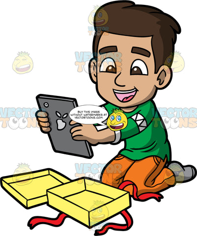 Young Gabriel Taking A Gift Out Of A Box. A Hispanic boy wearing orange pants, a green sweater, and gray socks, kneeling on the floor, happy about the tablet he just got as a gift