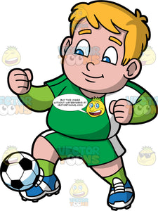 Young Sam Having Fun Playing Soccer. A chubby young boy wearing green shorts, a green with white shirt, green socks, and blue soccer cleats, running and kicking a soccer ball