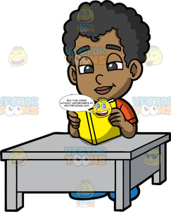 Jimmy Sitting At A Table Reading A Book. A black boy wearing an orange shirt, sitting down at a gray table and reading a book with a yellow cover