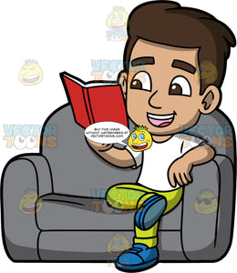 Young Gabriel Reading A Book. A Hispanic boy wearing lime green pants, a white t-shirt, and blue shoes, sitting on a comfortable gray chair reading a book with a red cover