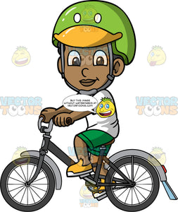 Young Jimmy Going For A Bike Ride. A young black boy wearing a green and yellow helmet, green shorts, a white t-shirt, and yellow shoes, riding around on his bike