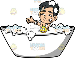 Kevin Washing Himself In The Tub. An Asian boy sitting in a white bathtub filled with bubbles, washing himself with a wash cloth