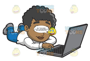 A Black Boy Using A Laptop